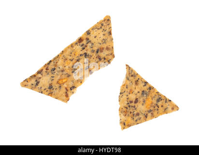 A single beans and rice chip broken in half isolated on a white background. - Stock Photo