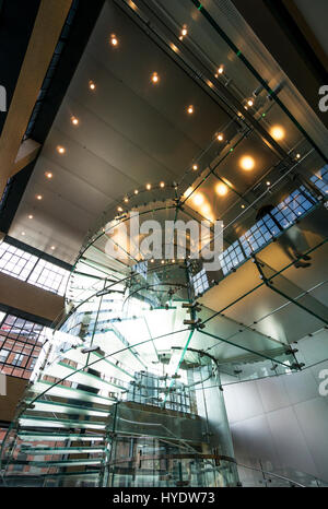 Winding glass staircase in 14th Street Apple Store in Chelsea, New York City - Stock Photo