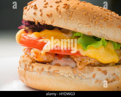 Big burger with french fries and ketchup on white plate. Fast food. Unhealthy dish. - Stock Photo