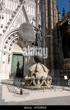 In front of the massive Saint Christopher door, part of Seville Cathedral in Seville, Spain, is the statue of 'El - Stock Photo