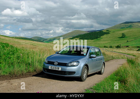VW Golf TDi in the Cheviot Hills, Northumberland - Stock Photo
