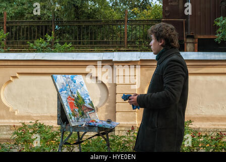 PETERSBURG, RUSSIA, September 24: Student artist draws building naval school named after Admiral Makarov, 24 September - Stock Photo