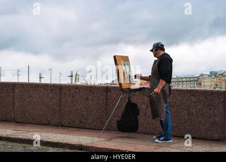 SAINT PETERSBURG, RUSSIA, may 14: the Artist with his easel draws the Rostral column on the Vasilievsky island, - Stock Photo