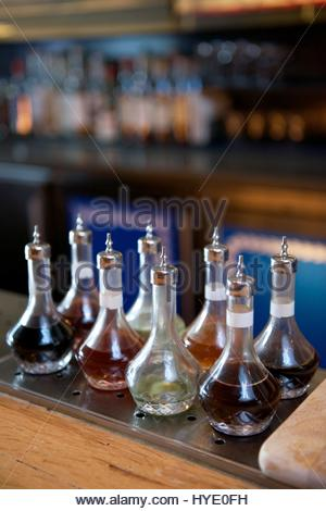 A variety of bitters and simple syrups for mixing drinks at a restaurant in the SOMA district. - Stock Photo