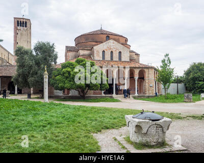 Chiesa di Santa Fosca and Bell Tower (campanile) on the island of Torcello in the Venetian lagoon, Venice, Italy - Stock Photo