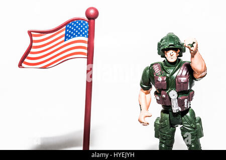 Toy soldier saluting the American flag - Stock Photo