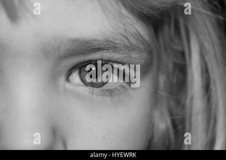 little girl's eye in black and white - Stock Photo