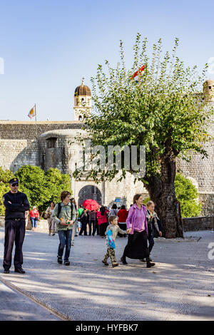 Tourists visiting the wall city in Dubrovnik - Stock Photo
