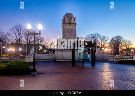 Liberty Bell replica in front of Union Station and Christopher Columbus statue at night - Washington, D.C., USA - Stock Photo
