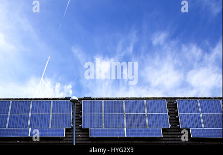Solar panels on house roof with blue sky in background.Renewable energy source,Stoke on Trent,Staffordshire,United - Stock Photo