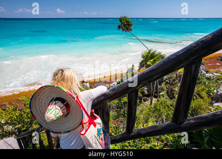 Woman posing, watching the beach in Tulum mayan ruins in Mexico - Stock Photo