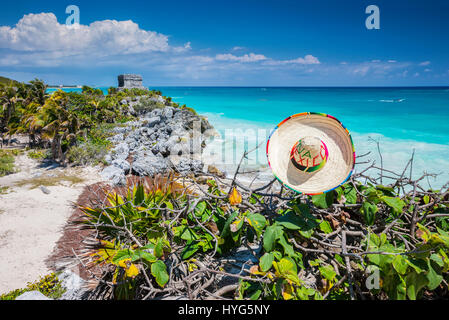 Sombrero, straw hat and Mayan pyramid in Tulum, Mexico - Stock Photo