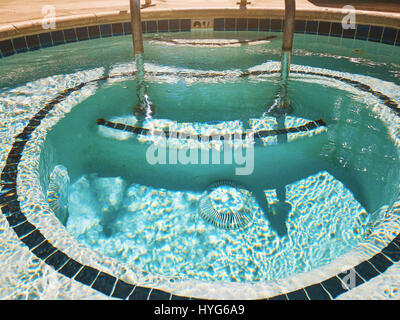 Outdoor Jacuzzi Pool with Fresh Blue Water for Massage and Spa - Stock Photo