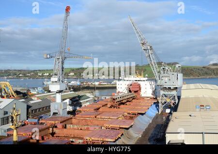 Large Cargo Ship undergoing maintenance in Falmouth Docks - Stock Photo