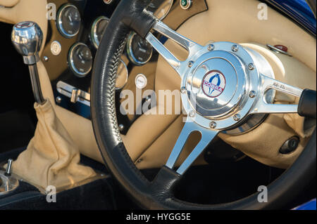 FARNBOROUGH, UK - APRIL 6: Iconic AC Cobra sports car interior on display at the annual Wheels Day auto and bike - Stock Photo