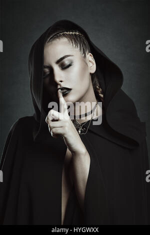 Silence gesture from beautiful vampire. Dark beauty - Stock Photo