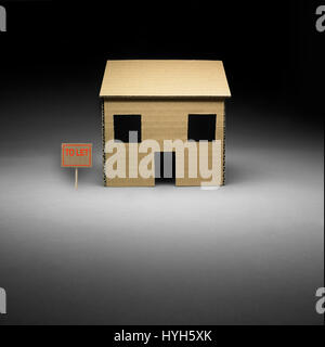 Cardboard House to let. - Stock Photo
