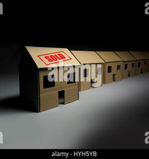 Row of Cardboard Houses, one sold. - Stock Photo