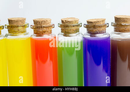 Colored liquids in five test tubes isolated over white background - Stock Photo