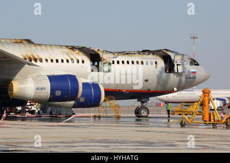 SHEREMETYEVO, MOSCOW REGION, RUSSIA - JUNE 3, 2014: Aeroflot Ilyushin IL-96-300 caught fire while standing at Sheremetyevo - Stock Photo