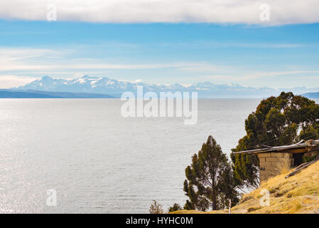 The majestic Cordillera Real mountain range at the horizon of the Titicaca Lake. Telephoto view from the Island - Stock Photo