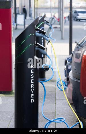 Electric car recharging batteries at a charging terminal. Milton Keynes, Buckinghamshire, England - Stock Photo