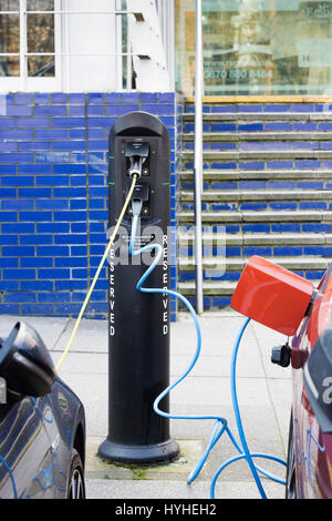 Electric car recharging batteries at a charging terminal. Milton Keynes, Buckinghamshire, England - Stock Photo