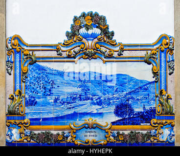 Historic ceramic tiles, azulejos, depicting the panorama of Pinhao with river and vineyards, Pinhao, Douro Valley, - Stock Photo