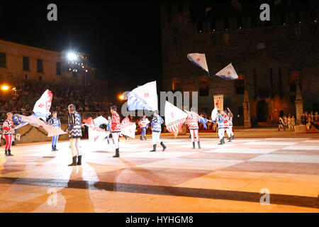 Marostica, VI, Italy - September 9, 2016: flag wavers during night fantastic show with Evolutions of big flags