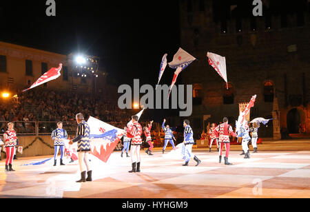 Marostica, VI, Italy - September 9, 2016: flag wavers during great show in the main square of town called Piazza degli Scacchi