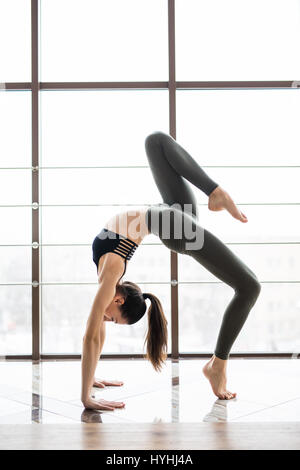 woman in yoga class making reverse prayer pose healthy