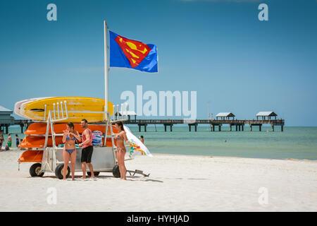 Beachgoers at Kayak rental business on the Popular white sand beach on Clearwater Beach, Florida, near Pier 60 & - Stock Photo