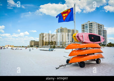 White sand beach on Clearwater Beach, Florida, with a stack of colorful kayaks for rent, in front of the hotels - Stock Photo