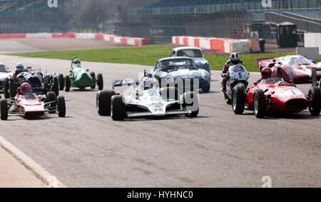 A  group  of Classic Racing cars from different eras and groups, parade around the Silverstone Circuit, for the - Stock Photo