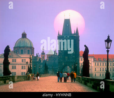 Sun rising over the Charles Bridge, Prague, Czech Republic. - Stock Photo