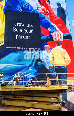 Giant mural Mercedes Benz advertisement in Mitte Berlin. Advertising Slogan,Grow up be a good parent. Commercial - Stock Photo
