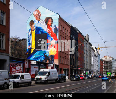 Giant mural Mercedes Benz advertisement in Mitte Berlin. Advertising Slogan,Grow up,be a good parent - Stock Photo