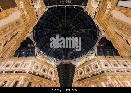 Night view of Galleria Vittorio Emanuele II shopping arcade, Milan, Lombardy, Italy - Stock Photo