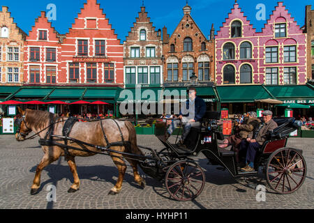 Horse carriage in Markt or Market Square, Bruges, West Flanders, Belgium - Stock Photo