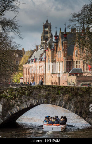 Tourist boat in Dijver canal, Bruges, West Flanders, Belgium - Stock Photo