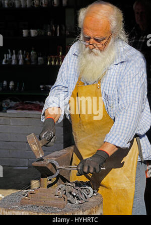 Blacksmith making horse shoes in Cetinje, Montenegro. - Stock Photo
