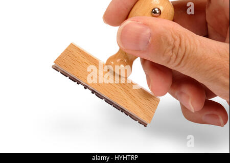 blank rubber stamp in hand and ready for your text - Stock Photo