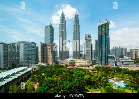 Petronas Twin Towers and Central Kuala Lumpur Skyline across KLCC Park, Malaysia - Stock Photo