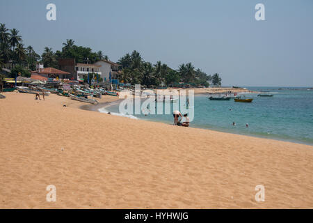 Sri Lanka, near Galle, coastal town of Unawatuna. Calamander Unawatuna Beach, major tourist attraction and top five - Stock Photo
