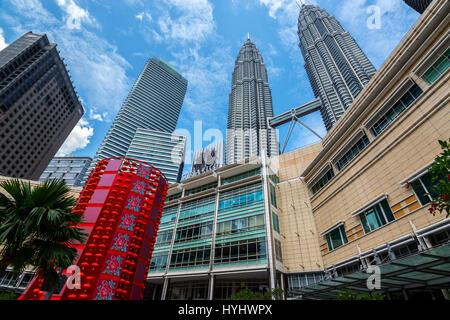 Petronas Twin Towers and Suria KLCC Shopping Mall, Kuala Lumpur, Malaysia - Stock Photo