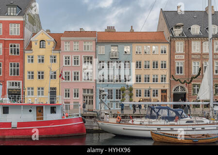 COPENHAGEN, DENMARK - DECEMBER 24, 2016: Nyhavn district is one of the most famous landmarks in Copenhagen, Denmark - Stock Photo