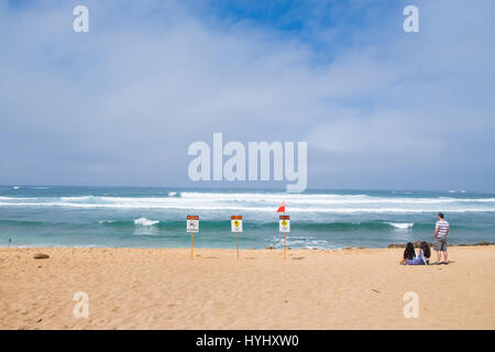 HALEIWA, OAHU, HAWAII - FEBRUARY 15, 2017: High surf warnings and a strong riptide prompt lifeguards to put up a - Stock Photo
