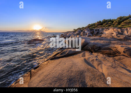 sunrise in Orange Beach. The east coast of Sithonia peninsula, Halkidiki, Greece - Stock Photo