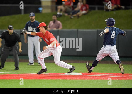 HOUSTON -- Rice infielder Ford Proctor (8) does not beat the throw to Houston infielder Lael Lockhart (37)during - Stock Photo