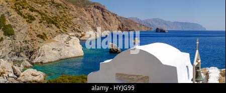 Romantic panorama view of Agia Anna beach with chapel on Amorgos island, Cyclades, Greece - Stock Photo